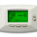 Close up of digital thermostat with time and temperature