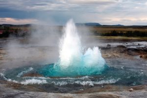 Geyser sending up hot water and steam
